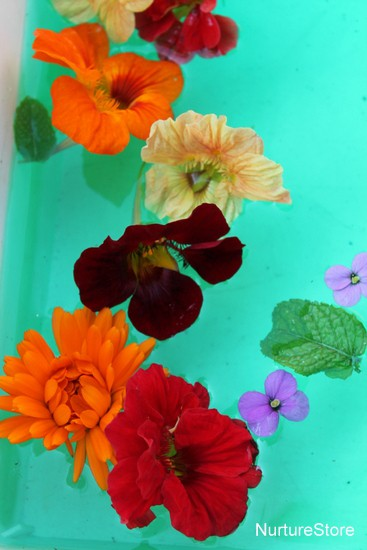 water play activity with flowers