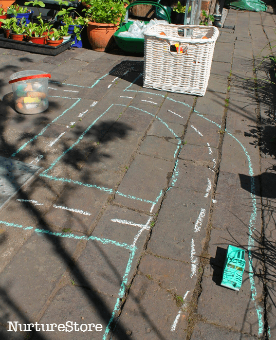 using chalk to draw a town for imaginary play