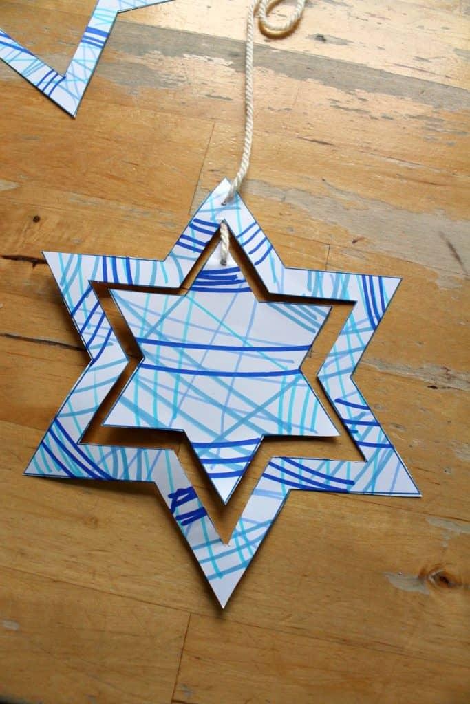 Spinning star mobile craft with template - NurtureStore