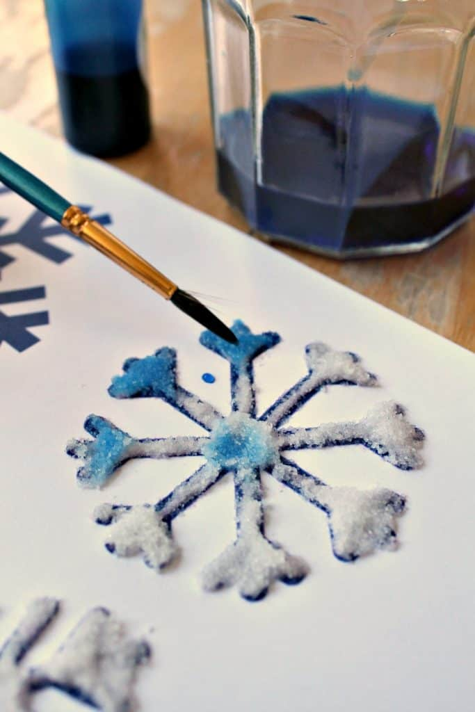 watercolor painting on salt and glue to make snowflake art