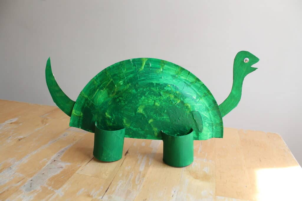 easy dinosaur model made from a paper plate and toilet roll tube